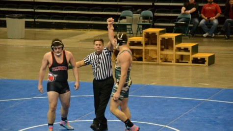 Senior Ryan Cloud being announced as winner over his Tecumseh High School opponent (Photo courtesy of northmontathletics.com).