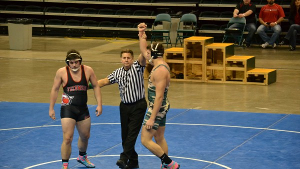 Senior Ryan Cloud being announced as winner over his Tecumseh High School opponent (Photo courtesy of northmontathletics.com).