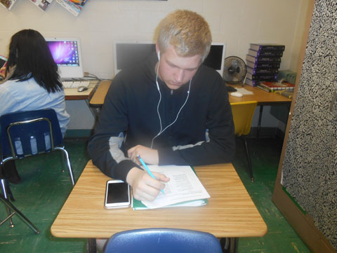 Sophomore Michael Wright listens to his music while working on an assignment