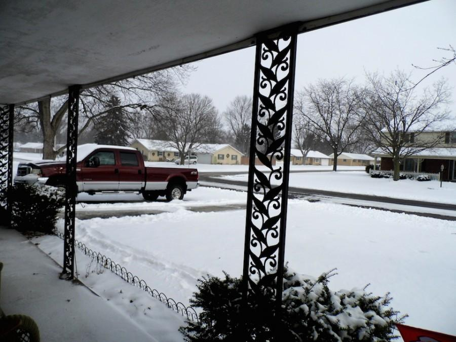 Sia+Skoryk+looks+out+the+front+door+of+her+host+family%27s+home+in+Englewood+on+a+January+Snow+Day.