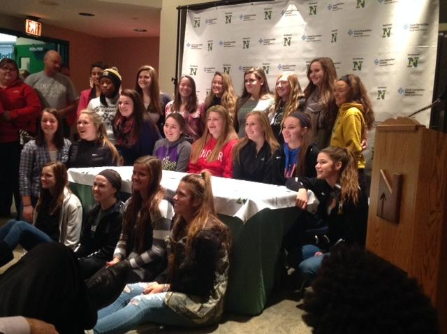 The+softball+team+celebrates+Signing+Day+with+seniors+Kendal+Benning+and+Amanda+Rose.