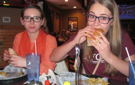 Exchange students Sia Skoryk And Franzi Schuetze enjoy dinner at T.J. Chumps in Englewood.