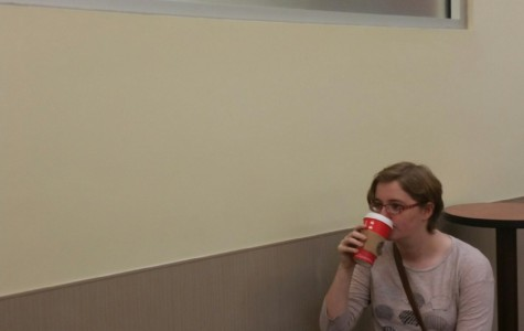 Newspaper irregular senior Meghan Jenkins sips from the controversial red cup in a nearby Starbucks.