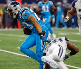 Panthers safety Kurt Coleman breaks a tackle before scoring on an interception return early in the first quarter the Panthers' Thanksgiving win (picture and caption from The Associated Press).
