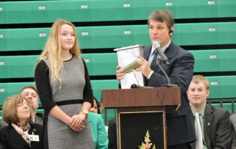 School Board Student Representative senior Samantha Johnson and principal George Caras present the time capsule at the dedication of the new high school building on January 10, 2016.