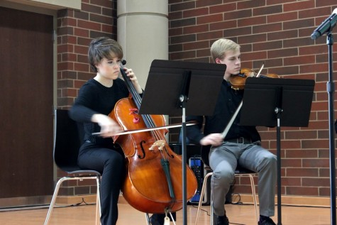 Orchestra members senior Anna Drew and Robbie Spilker perform at the dedication.