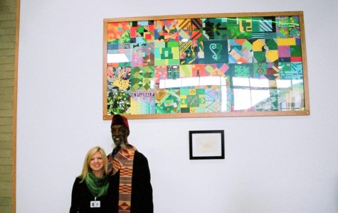 Art teacher Ms. Bethany Allen and Bing Davis stand in front of the permanent art piece in the new high school (Photo courtesy of Mr. Steve Shaw).