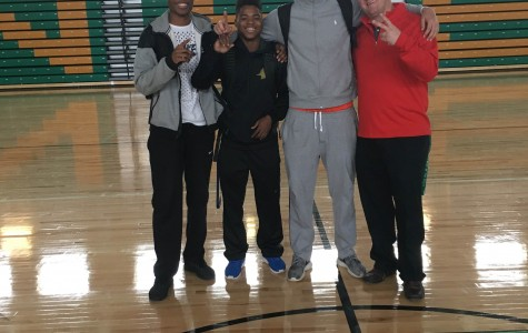 Seniors Jason Biggs, Myles Tanner, and Jarrell Taylor with Head Coach Collin Abels in the Thunderdome.