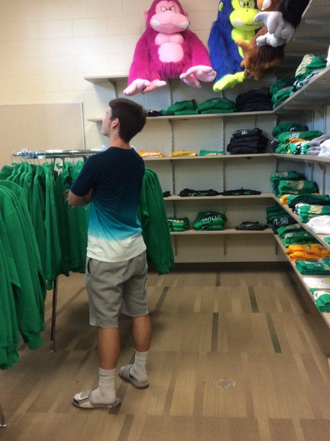 Senior Kellen O'Shea admires the merchandise