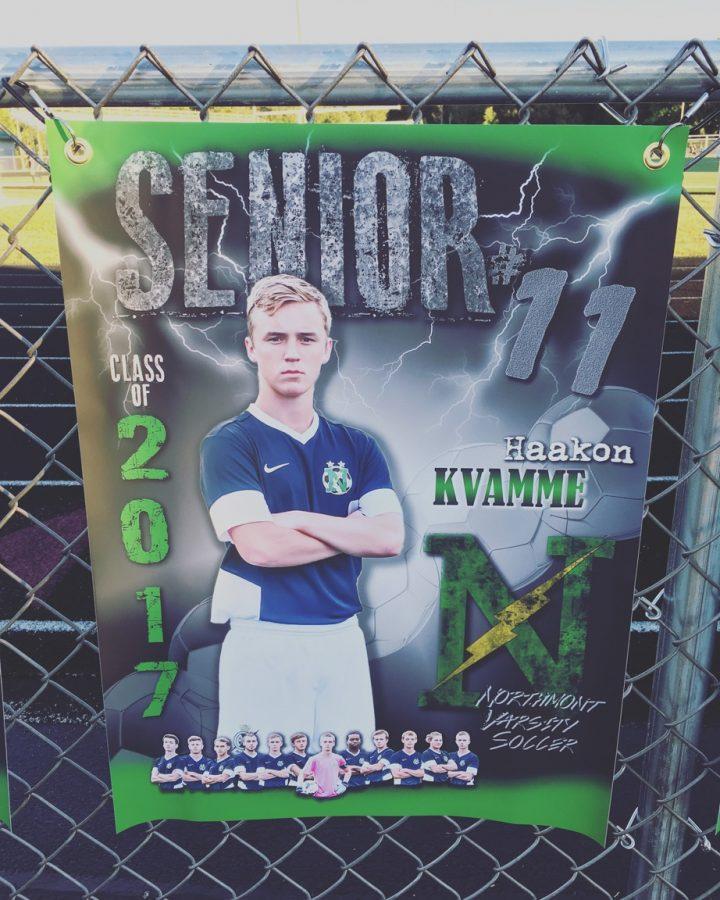 Haakon+Kvamme+poses+for+his+senior+soccer+poster.+