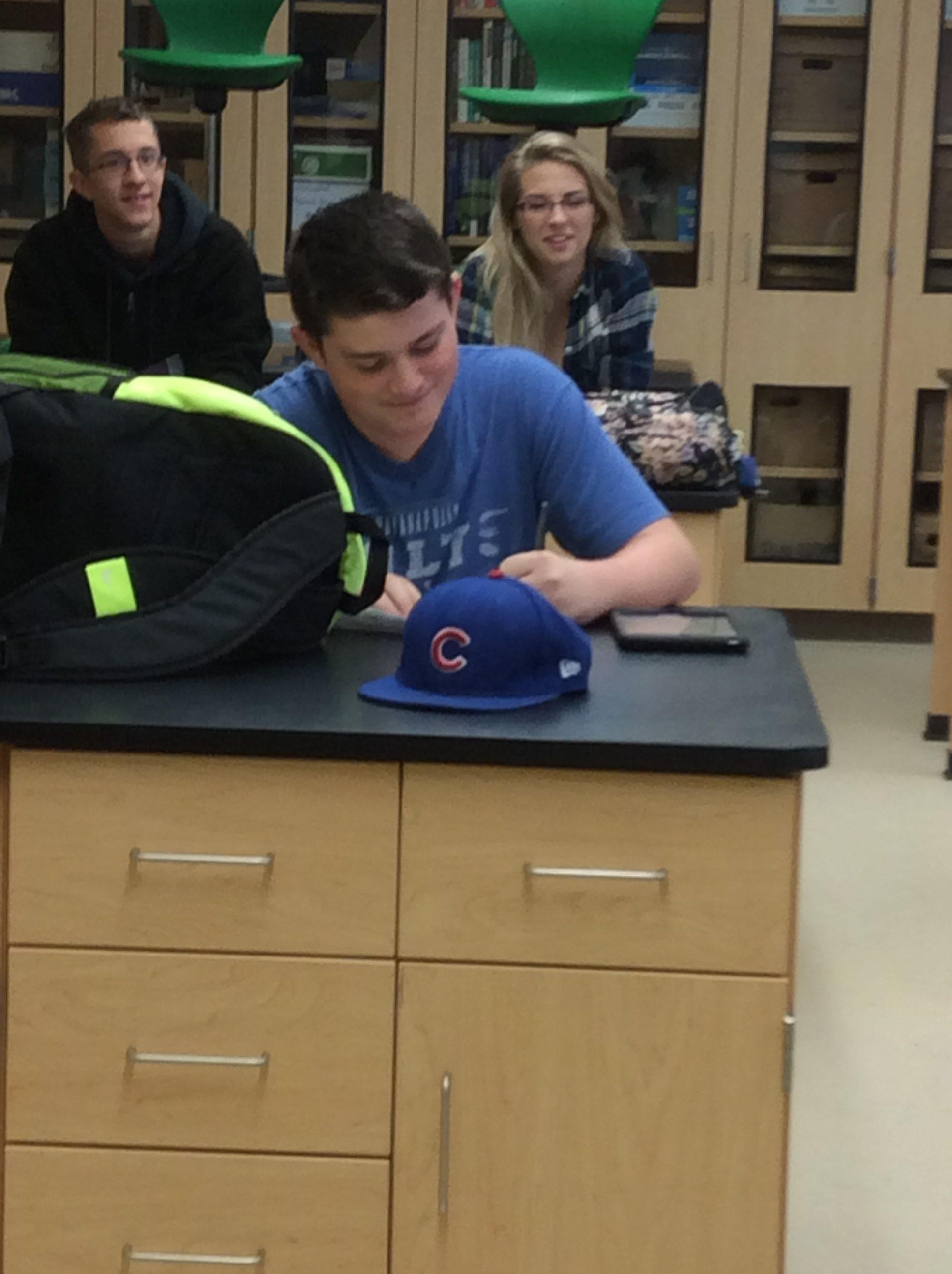 Freshman Jake Hughes supports the Chicago Cubs while in his Biology class.