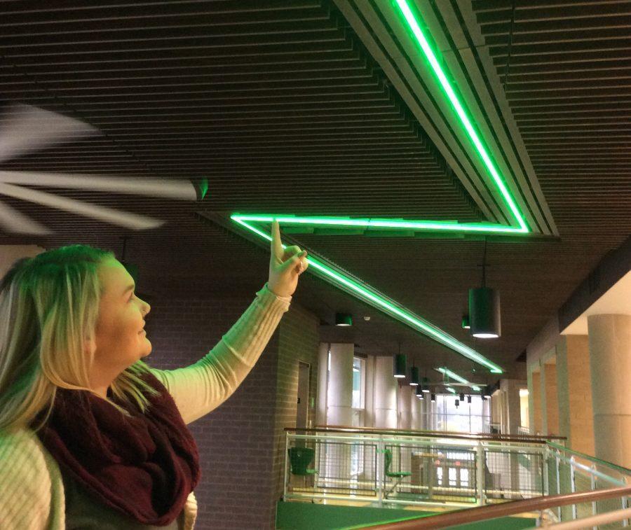Freshman Grace Rohling points out the green lightning bolt that runs along Thunderbolt Way.