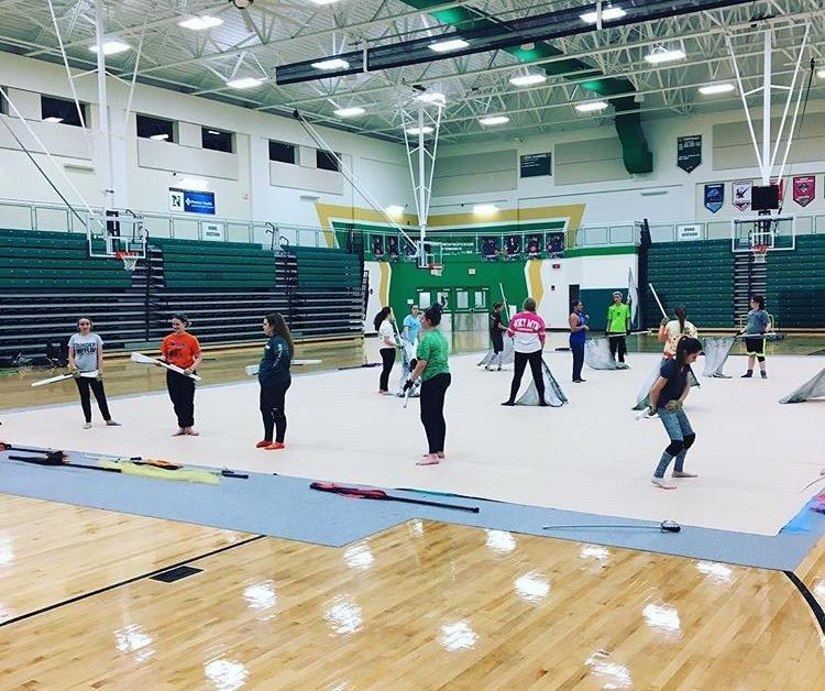 Northmont Winter Guard practices in the gym.