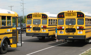 With less than one month left of school, students leave on buses.