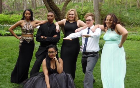 Junior Alecia Barker, junior Dion Wilkins, junior Breanna Sharp, senior David Sutter, and sophomore Faith Thompson, with senior Kiani Hayes in front, take prom pictures at Allwood Garden Metropark(photo courtesy of Thompson).