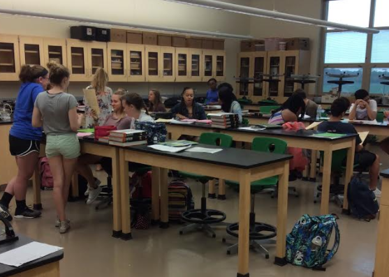 Mr. William Patrizio's second period advanced chemistry class prepares for a test over acids and bases.