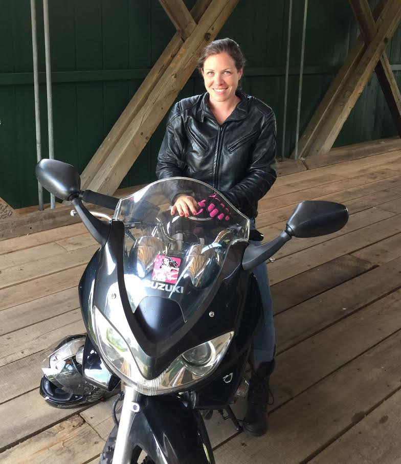 Ms.Chrissy+Galaise+stops+her+Suzuki+on+a+covered+bridge.
