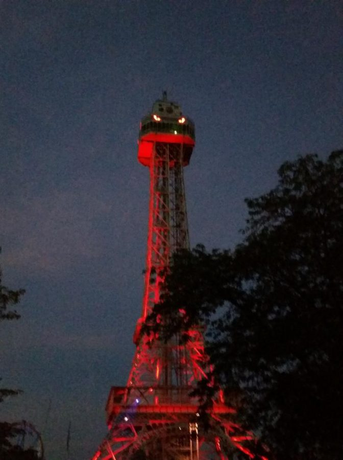 Kings Island's Eiffel Tower lights up during the park's annual Halloween Haunt.