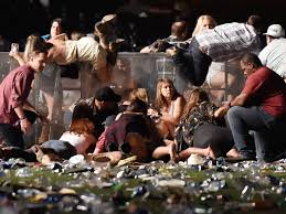 People take cover at the concert as the shots begin (courtesy of CNN).