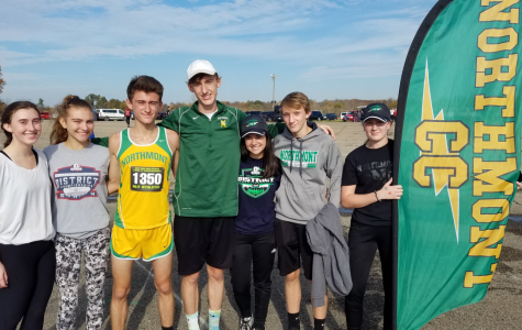Cross Country athletes stand together at National Trail Raceway after Beireis's race (courtesy of @NThunderbolts on Twitter). Beireis is third from left.