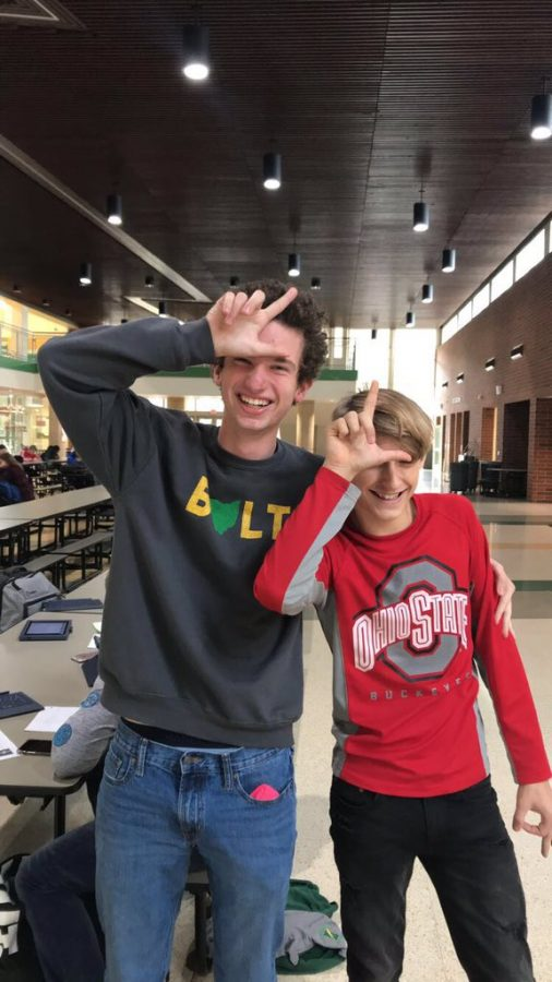 Junior Drew Haker(left) and freshman Conner Jacobs(right) hold up L's symbolizing their school year.