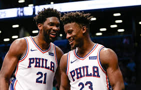 Jimmy Butler shares a laugh with his new teammate Joel Embiid after a big win against the New Orleans Pelicans (Sports Center).