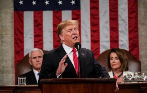 President Trump speaking style his podium (image courtesy of USA Today)