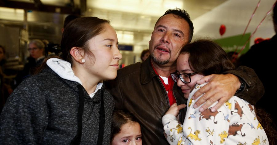 Fernando Arredondo of Guatemala reunites with his daughters Andrea, left, Keyli, right, and Alison, second from left, at Los Angeles International Airport after being separated during the Trump administration's  separation of immigrant families.