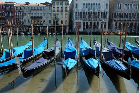 Docked boats in Venice canals allows sediment in the waterways to settle