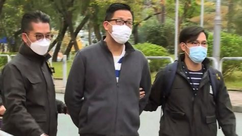 A photo taken from a video posted to Facebook which shows former lawmaker Lam Cheuk-Ting getting arrested. Photo credit : TVB via AP(associated press)