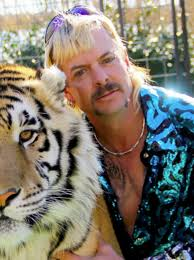 Joe Exotic with one of his big cats at his zoo, GW Zoo Credit: Boston Globe