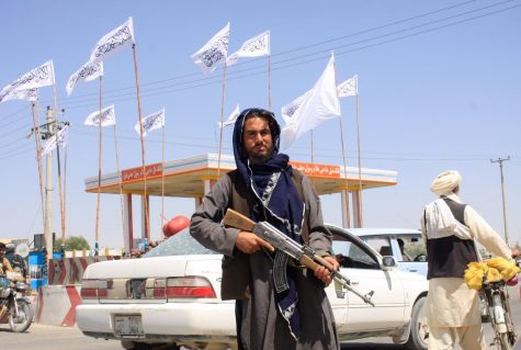 """""""A Taliban fighter looks on as he stands at the city of Ghazni, Afghanistan August 14, 2021. """""""